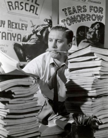 "1952 --- Original caption: 1952-Movie still of Kirk Douglas struggling behind a desk full of scripts in ""The Bad and the Beautiful,"" directed by Vincente Minelli. --- Image by © Corbis"